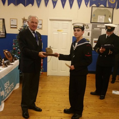 The Commodore presents to Sea Cadet 2016