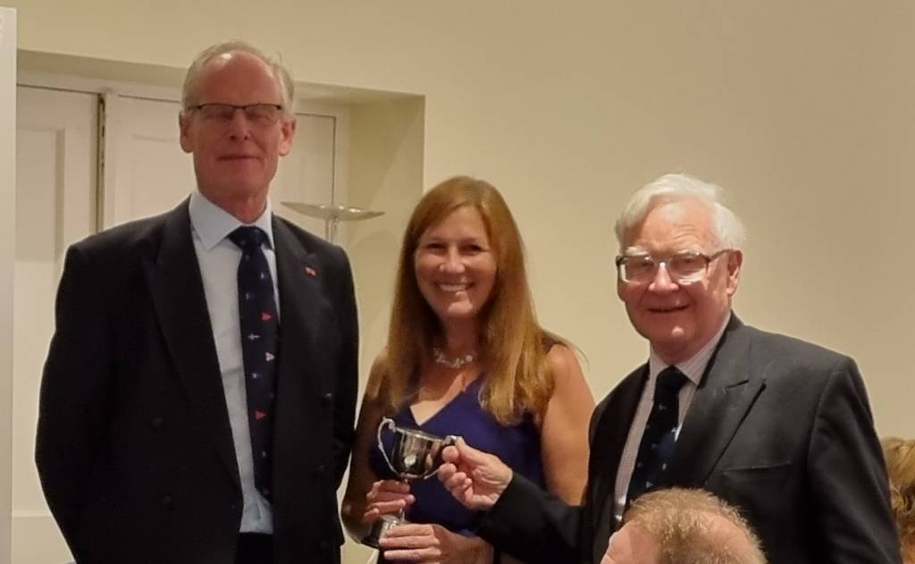 Chris Preston presents the Craig Cup to Actuaries Master, Julie Griffiths and Richard Hawkes.