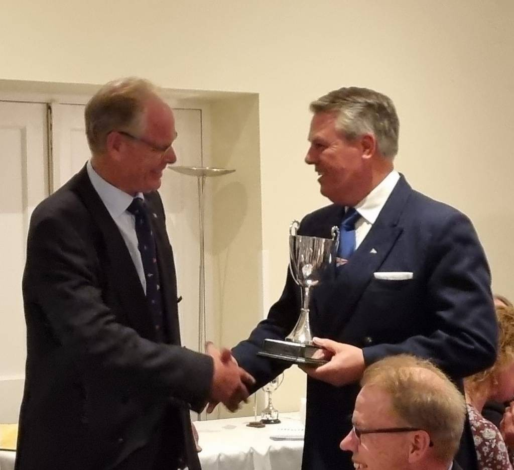 John Sparshatt-Worley collects the Epsom Cup from his Skipper, Chris Preston