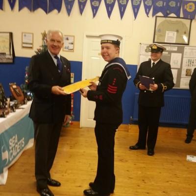 The Commodore presents to Sea Cadet 2016